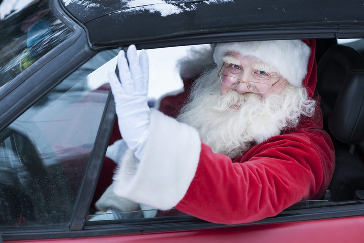 santa claus waving from his car jerome and summey insurance